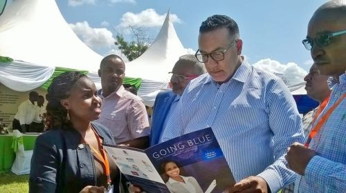Blue Company Secretariat, Mary Waceke, presenting the anti-corruption initiative to the Cabinet Secretary for Tourism, Najib Balala, at the 17th Annual KAHC Symposium held on July 2019 at the Neptune Paradise Resort & Spa in Kwale County.