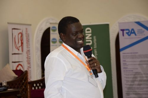 Regional CEO of Jubilee Holdings, Dr Julius Kipngetich, giving a speech at The 17th Annual KAHC Symposium held on July 2019 at the Neptune Paradise Resort & Spa in Kwale County.