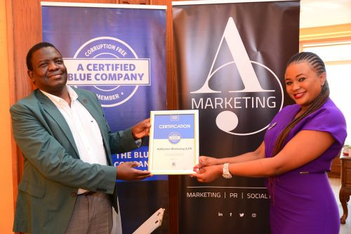 Addleston Marketing & PR Chief Executive Officer, Kendi Perpetual, receiving the Blue Company Certification from Executive Advisory Board Member of the Blue Company, Dr. Julius Kipngetich