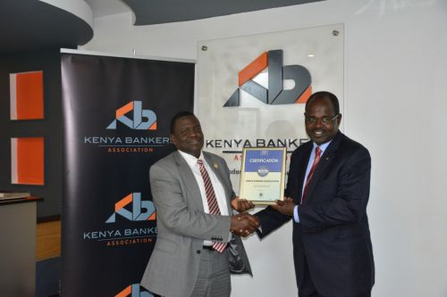 Kenya Bankers Association CEO, Dr Habil Olaka, receiving the Blue Company Certification from Jubilee Holdings CEO/ Executive Board Member of the Blue Company, Dr. Julius Kipngetich