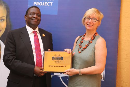 Kiboko Leisure Wear Managing Director, Ms. Sabine Huster, receiving the Blue Company Certification from Jubilee Holdings CEO/ Executive Board Member of the Blue Company, Dr. Julius Kipngetich