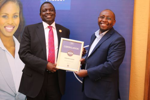 Sunworld Safaris Limited Head of  Human Resources, Julius, receiving the Blue Company Certification from Jubilee Holdings CEO/ Executive Board Member of the Blue Company, Dr. Julius Kipngetich