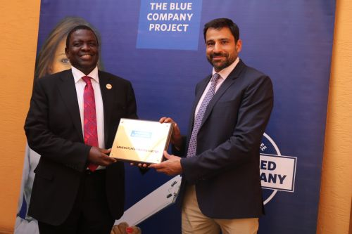 Gamewatchers Safaris CEO, Dr. Mohanjeet, receiving the Blue Company Certification from Jubilee Holdings CEO/ Executive Board Member of the Blue Company, Dr. Julius Kipngetich