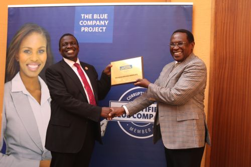 Polucon Services Kenya Chairman, Dominic Mathenge, receiving the Blue Company Certification from Jubilee Holdings CEO/ Executive Board Member of the Blue Company, Dr. Julius Kipngetich