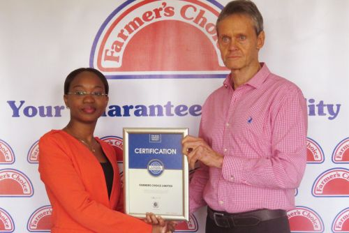 Farmers Choice Managing Director, James Taylor receiving the Blue Company Certification from UN Global Compact Network Kenya Coordinator Ms. Judy Njino