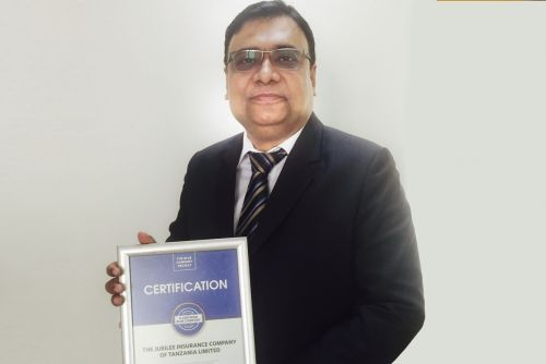 Jubilee Insurance Tanzania General CEO, Depanker Acharya possess for a picture after receiving the Blue Company Certification