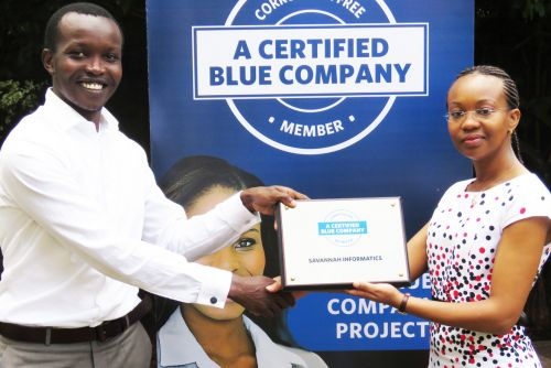 Savannah Informatics Managing Director, John Muthee receiving the Blue Company Certification from UN Global Compact Network Kenya Coordinator Ms. Judy Njino