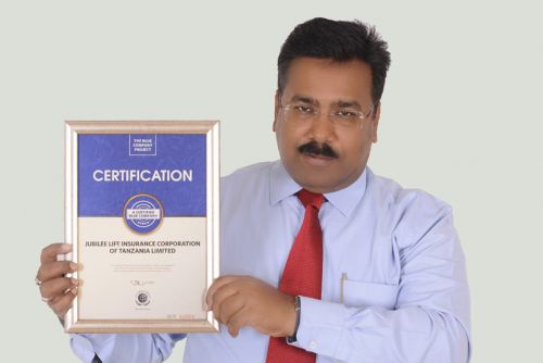 Jubilee Insurance Tanzania Life CEO, Sumit Gaurav possess for a picture after receiving the Blue Company Certification