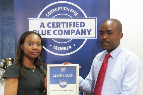Gertrude's Children Hospital CEO, Robert Nyarango receiving the Blue Company Certification from UN Global Compact Network Kenya Coordinator Ms. Judy Njino