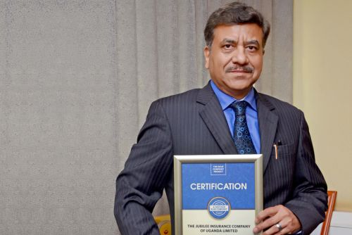 Jubilee Insurance Uganda General CEO, Deepak Pandey possess for a picture after receiving the Blue Company Certification