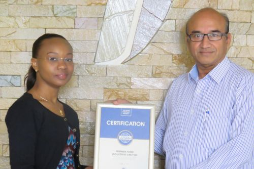 Premier Industries Limited CEO, Sadrudin Dharmarajan receiving the Blue Company Certification from UN Global Compact Network Kenya Coordinator Ms. Judy Njino