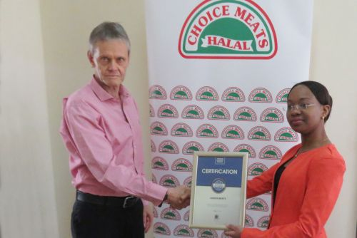 Choice Meats Managing Director, James Taylor receiving the Blue Company Certification from UN Global Compact Network Kenya Coordinator Ms. Judy Njino