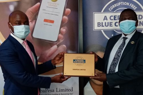UbaPesa Limited Chief Executive Officer, George Ngabo Wasike, receiving the Blue Company Certification from Executive Advisory Board Member of the Blue Company, Dr. Julius Kipngetich
