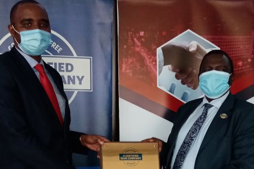 Smartron Limited Chief Executive Officer, Ronald Meru, receiving the Blue Company Certification from Executive Advisory Board Member of the Blue Company, Dr. Julius Kipngetich