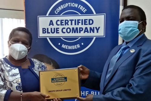Arope Group Ltd Chief Executive Officer, Victoria Mulwa, receiving the Blue Company Certification from Executive Advisory Board Member of the Blue Company, Dr. Julius Kipngetich