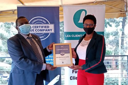 LEA Client services Chief Executive Officer, Wambui Karanja, receiving the Blue Company Certification from Executive Advisory Board Member of the Blue Company, Dr. Julius Kipngetich