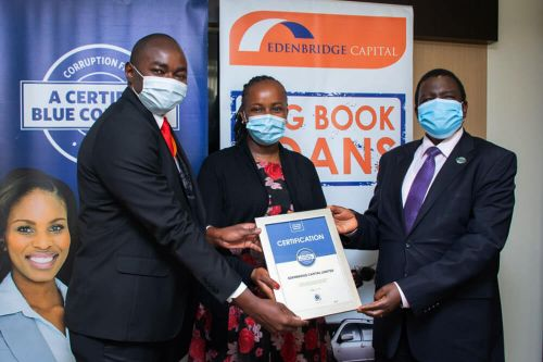 Edenbridge Capital Limited Managing Director, Reuben Mwangi Kimani and Director Beth Muigai receiving the Blue Company Certification from Executive Advisory Board Member of the Blue Company, Dr. Julius Kipngetich