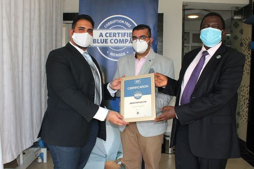 ARKN PHYSIO LTD Chief Executive Officer, Dr Aly Meghji , receiving the Blue Company Certification from Executive Advisory Board Member of the Blue Company, Dr. Julius Kipngetich