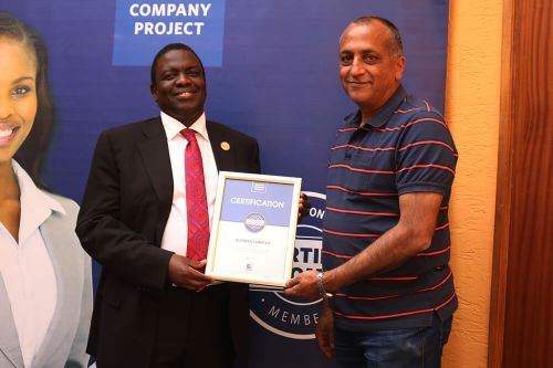 Autoskill Ltd Chief Executive Officer, Jitendra.R Khetia, receiving the Blue Company Certification from Executive Advisory Board Member of the Blue Company, Dr. Julius Kipngetich