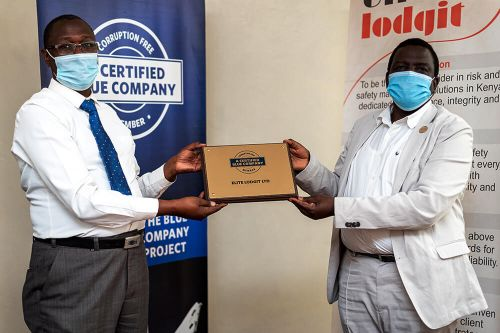 Elite Lodgit Chief Executive Officer, Silas Salaton, receiving the Blue Company Certification from Executive Advisory Board Member of the Blue Company, Dr. Julius Kipngetich