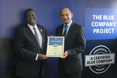 Go Places Managing Director, Mansoor Jiwani, receiving the Blue Company Certification receiving the Blue Company Certification from Executive Advisory Board Member of the Blue Company, Dr. Julius Kipngetich