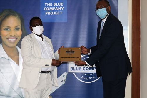 Kenbright Actuarial and Financial Services, Chief Executive Officer, Ezekiel Macharia, receiving the Blue Company Certification from Executive Advisory Board Member of the Blue Company, Dr Julius Kipngetich