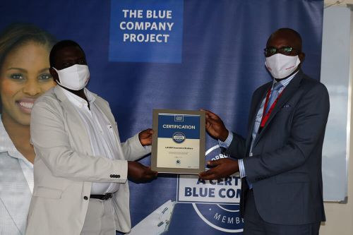Laser Insurance Brokers, Executive Director, Jonathan Marucha, receiving the Blue Company Certification from Executive Advisory Board Member of the Blue Company, Dr Julius Kipngetich.