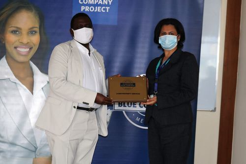 Laser Property Services, General Manager, Shafana Rajani, receiving the Blue Company Certification from Executive Advisory Board Member of the Blue Company, Dr Julius Kipngetich