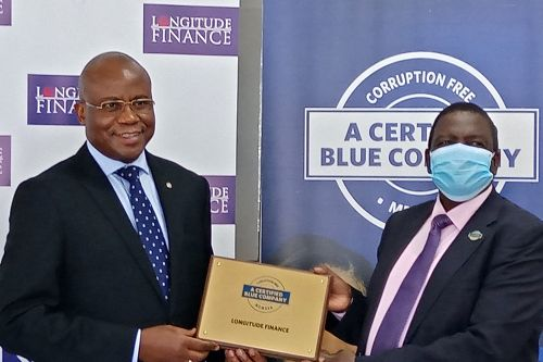Longitude Finance Chief Executive Officer, Michael Monari, receiving the Blue Company Certification from Executive Advisory Board Member of the Blue Company, Dr. Julius Kipngetich