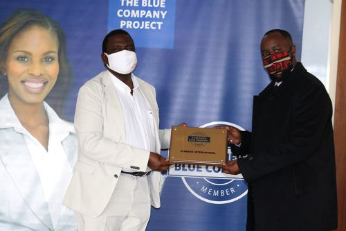 Synkron International, Chief Executive Officer, Kenneth Mantu, receiving the Blue Company Certification from Executive Advisory Board Member of the Blue Company, Dr Julius Kipngetich