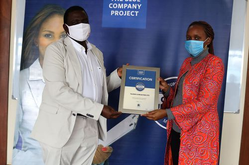Tilvera Consulting Ltd, Chief Executive Officer, Muthoni Muchai, receiving the Blue Company Certification from Executive Advisory Board Member of the Blue Company, Dr. Julius Kipngetich