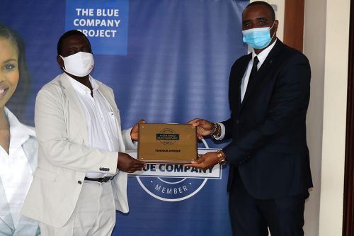 Vendeur Afrique, Director of Business Development and Strategy, Ronald Meru, receiving the Blue Company Certification from Executive Advisory Board Member of the Blue Company, Dr Julius Kipngetich